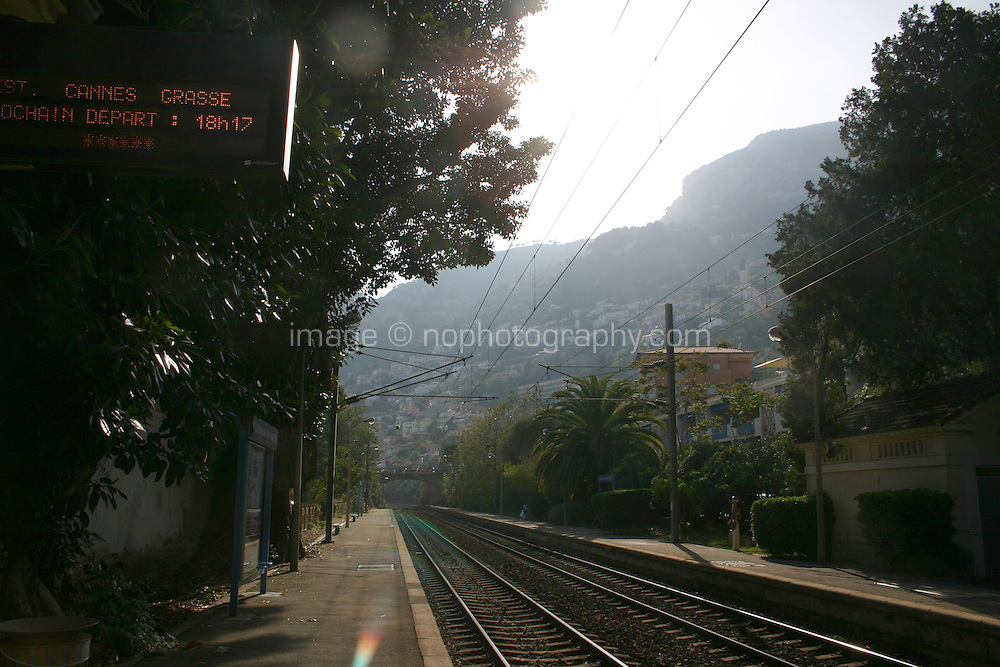 Roquebrune Cap Martin train station in South of France with lens flare