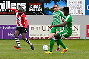 Hiram Boateng (44) of Exeter City crosses the ball for Jayden Stockley (11) of Exeter City to score the third Exeter goal during the EFL Sky Bet League 2 match between Exeter City and Swindon Town at St James' Park, Exeter, England on 24 March 2018. Picture by Graham Hunt.