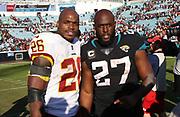Dec 16, 2018; Jacksonville, FL, USA; Washington Redskins running back Adrian Peterson (26) and Jacksonville Jaguars running back Leonard Fournette (27) pose after an NFL game at TIAA Bank Field. The Redskins beat the Jaguars 16-13. (Steve Jacobson/Image of Sport)