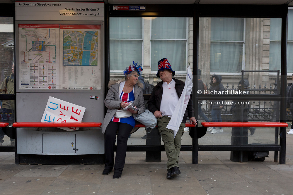 After threee and a half years of political upheavel in the British parliament, two Brexiteers rest while celebrating in Westminster on Brexit Day, the day when the UK legally leaves the European Union, on 31st January 2020, in London, England.