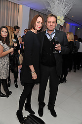 KEELEY HAWES and PHILIP GLENISTER at the pre party for the English National Ballet's Christmas performance of The Nutcracker held at the St.Martin's Lane Hotel, St.Martin's Lane, London on 14th December 2011.