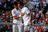 LONDON, ENGLAND - JULY 06: Novak Djokovic of Serbia meet at net with Roger Federer of Switzerland after their Gentlemen's Singles Final match on day thirteen of the Wimbledon Lawn Tennis Championships at the All England Lawn Tennis and Croquet Club on July 6, 2014 in London, England.