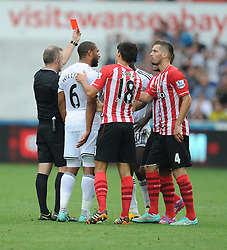 Swansea City's Wilfried Bony gets sent off after his tackle on Southampton's Maya Yoshida - Photo mandatory by-line: Alex James/JMP - Mobile: 07966 386802 20/09/2014 - SPORT - FOOTBALL - Swansea - Liberty Stadium - Swansea City v Southampton  - Barclays Premier League