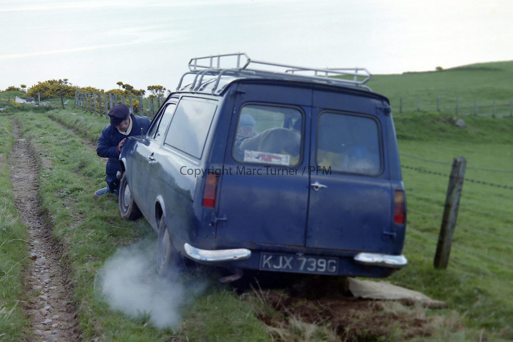Historic Scottish Series Images<br /> <br /> 1977, Sandy Taggart helping out get a committee members car out a ditch.<br /> <br /> Picture Copyright  PFM Pictures