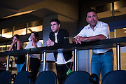 Oscar De La Hoya looks out over the arena with his son, Devon and daughter, Atiana, before at AT&T Stadium in Arlington, Texas before heading back to the hotel at the end of the night on September 16, 2016.  (Cooper Neill for ESPN)
