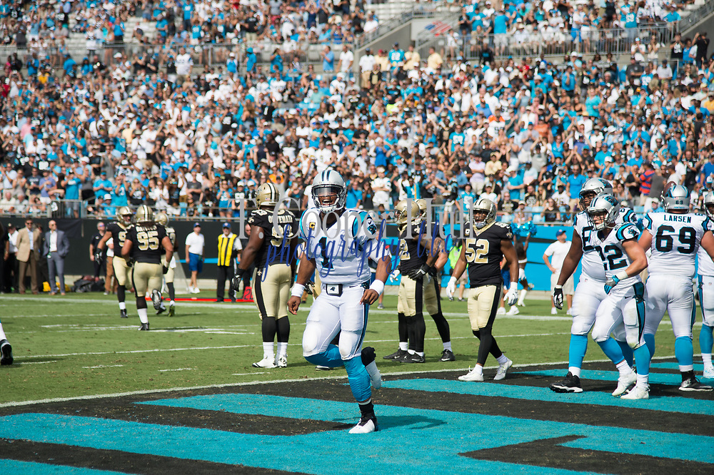 Cam Newton(1) celebrates his touchdown in the New Orleans Saints 34 to 13 victory over the Carolina Panthers.