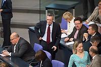 27 JUN 2013, BERLIN/GERMANY:<br /> Thomas de Maiziere, CDU, Bundesverteidigungsminister, auf dem Weg zu seinem Platz, vor Beginn der Regierungserklaeung der Bundeskanzlerin zum EU-Gipfel und Europaeischen Rat, Plenum, Deutscher Bundestag<br /> IMAGE: 20130627-01-003<br /> KEYWORDS: debatte, Sitzung