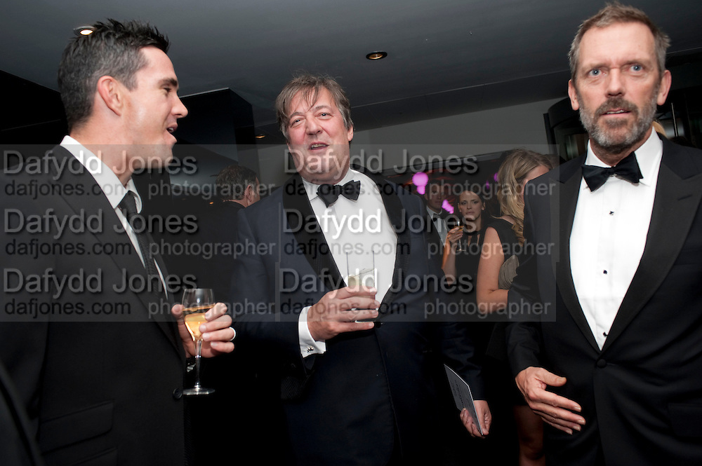 STEPHEN FRY; HUGH LAURIE, GQ Men of the Year awards. The royal Opera House. Covent Garden. London. 6 September 2011. <br /> <br />  , -DO NOT ARCHIVE-© Copyright Photograph by Dafydd Jones. 248 Clapham Rd. London SW9 0PZ. Tel 0207 820 0771. www.dafjones.com.
