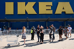 © Licensed to London News Pictures. 01/06/2020. London, UK. Customers practice social distancing queuing up outside the reopened Ikea furniture store in Wembley. The company closed its UK stores in the UK on March 20 due to the Coronavirus lockdown. Customers will experience enhanced cleaning and safety precautions and social distancing rules will be enforced. Photo credit: Ray Tang/LNP