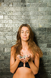 Aug. 23, 2012 - Woman holding stones (Credit Image: © Image Source/ZUMAPRESS.com)