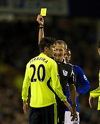 LIVERPOOL, ENGLAND - Thursday, April 17, 2008: Referee Martin Atkinson shows Chelsea's Paulo Ferreira the yellow card during the Premiership match against Everton at Goodison Park. (Photo by David Rawcliffe/Propaganda)