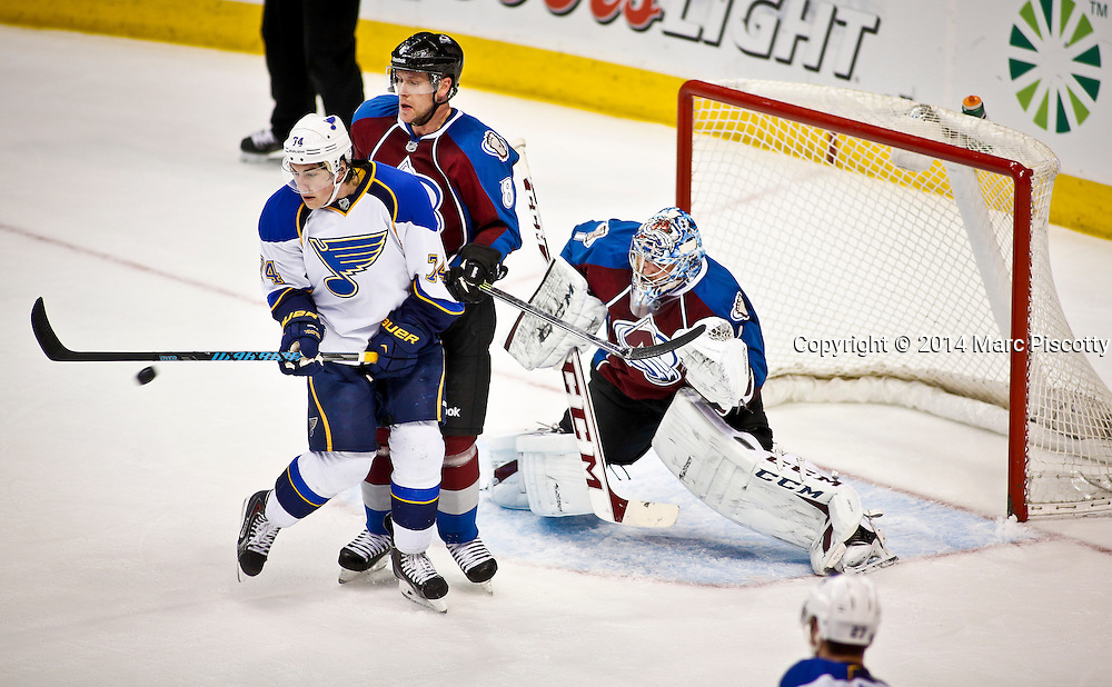 SHOT 3/8/14 2:36:40 PM - The St. Louis Blues' T.J. Oshie #74 tries to redirect a shot in front of the Colorado Avalanche's Jan Hejda #8 and goaltender Semyon Varlamov #1 during their regular season Western Conference game at the Pepsi Center in Denver, Co. The Blues won the game 2-1.<br /> (Photo by Marc Piscotty / &copy; 2014)