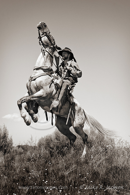Mountain Man on a rearing horse at a yearly Mountain Man Rendezvous in Wyoming.
