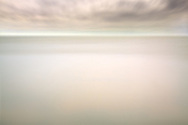 Rain and long exposure combined together to produce some interesting ethereal effect on this simple scene of just water and cloudy sky. Taken at the Etang de Vaccarés, the largest of Camargue in France, in a rainy and windy day.