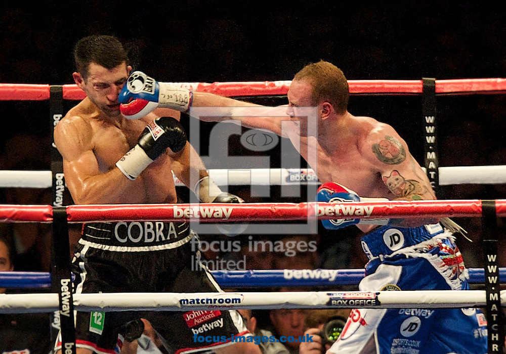 Carl Froch gets caught with a right hand from George Groves  pictured during the Froch v Groves IBF World Super Middleweight title rematch at Wembley Stadium, London<br /> Picture by Alan Stanford/Focus Images Ltd +44 7915 056117<br /> 31/05/2014