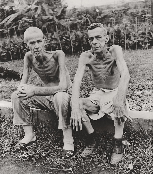 Carl Mydans<br /> LIFE Magazine<br /> Freed American Prisoners: Philippines Jan-Feb, 1945 <br /> <br /> Two emaciated American civilians, Lee Rogers (L) and John C. Todd, sit outside the gym which had been used as a hospital at the Japanese prison camp in Santo Tomas, Philippines. This article was published in the March 5, 1945 issue of LIFE Magazine.<br />  <br /> Details:<br /> - Vintage gelatin silver print, shot while on assignment for LIFE Magazine.<br /> - Photo date: January - February, 1945.<br /> - Print date: February, 1945.<br /> - Single weight, glossy fiber gelatin silver print.<br /> - Size: 7 1/2 in. x 6 3/4 inches (225 mm x 205 mm).<br /> <br /> Price &yen;60,000 JPY<br /> <br /> <br /> <br /> <br /> <br /> <br /> <br /> <br /> <br /> <br /> <br /> <br /> <br /> <br /> <br /> <br /> <br /> <br /> <br /> <br /> <br /> <br /> <br /> <br /> <br /> <br /> <br /> <br /> <br /> <br /> <br /> <br /> <br /> <br /> <br /> <br /> <br /> <br /> <br /> <br /> <br /> <br /> <br /> <br /> <br /> <br /> <br /> <br /> <br /> <br /> <br /> <br /> <br /> <br /> <br /> <br /> <br /> <br /> <br /> <br /> <br /> <br /> <br /> <br /> <br /> <br /> <br /> <br /> <br /> <br /> <br /> <br /> <br /> <br /> <br /> <br /> <br /> <br /> <br /> <br /> <br /> <br /> .