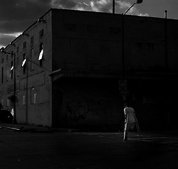 WASHINGTON, D.C., JUNE 28, 2014: A man who lost one of his legs moves on crutches along the warehouses at Union Market. (Photo by Astrid Riecken)