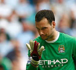 01.05.2010, City of Manchester Stadium, Manchester, ENG, PL, Manchester City vs Aston Villa im Bild Martin Fulop of Manchester City spits on his gloves to inprove grip after losing a couple of loose balls, EXPA Pictures © 2010, PhotoCredit EXPA/ Marc Atkins / SPORTIDA PHOTO AGENCY