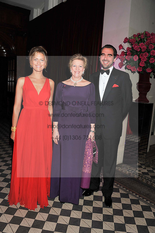Left to right, PRINCESS TATIANA OF GREECE, QUEEN ANNE-MARIE OF GREECE and PRINCE NIKOLAOS OF GREECE at the Red & Black Valentine's Dinner & Dance in aid of The Eve Appeal at One Mayfair, North Audley Street, London W1 on 14th February 2013.