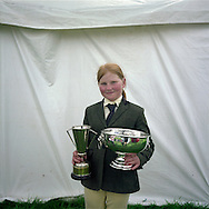 'The Holm Show, 2013' from 'A Fine Line - Exploring Scotland's Border with England' by Colin McPherson.<br /> <br /> A young Scottish girl with equestrian trophies won at the annual Holm Show in Newcastleton.<br /> <br /> The project was a one-year exploration of the border between the two historic nations, as seen from the Scottish side of the frontier.<br /> <br /> Colin McPherson is a photographer and visual artist based in north west England. In 2012 he was one of the founding members of Document Scotland, a collective of four Scottish documentary photographers brought together by a common vision to witness and photograph the important and diverse stories within Scotland at one of the most important times in our nation's history.<br /> <br /> 'A Fine Line' will be shown for the first time in public at Impressions Gallery, Bradford, from July 1 until September 27, 2014 to coincide with the Scottish Independence referendum.