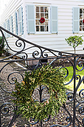 December 21, 2017 - Charleston, South Carolina, United States of America - A Christmas wreath hangs from a wrought iron gate on a historic home along King Street in Charleston, SC. (Credit Image: © Richard Ellis via ZUMA Wire)