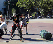 """**EXCLUSIVE**.Tim Robbins ignoring City Park's Playground Rules that Prohibits """"Roller Skates"""" and Adults without children was playing """"Roller Skate Hockey"""" with his male friends at William F. Passannante Ballfield Public Park..They also used the City's garbage pail as the goal posts..While a Mother was waiting at the bus stop with her son, the ball pass trough the fence and hit the boy's foot, he was crying, so Tim rushed out of the Park to take care of the little boy, one of Tim's teammates rushed inside a local grocery store and brought ice in a black bag. Tim attended to the boy by putting ice on his foot and verifying that it wasn't broken. Be on the look out for a lawsuit..West Village.New York City, NY, USA .Sunday, September 23, 2007.Photo By Celebrityvibe.com.To license this image call (212) 410 5354 or;.Email: celebrityvibe@gmail.com; ."""
