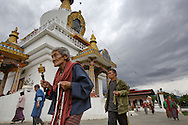 Worshippers walk around the National Memorial Chorten (Buddhist religious monument) in Thimphu, Bhutan on August 12, 2014. The Tibetan-style chorten, built in 1974 as a memorial to the third king, Jigme Dorji Wangchuck (1928–72), is the focus of daily worship among Buddhists in Thimpu. (Photo by Kuni Takahashi)