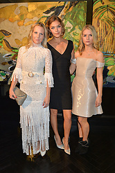 Left to right, ALICE NAYLOR-LEYLAND, ARIZONA MUSE and LOTTIE MOSS at a party to celebrate the launch of the Maddox Gallery at 9 Maddox Street, London on 3rd December 2015.