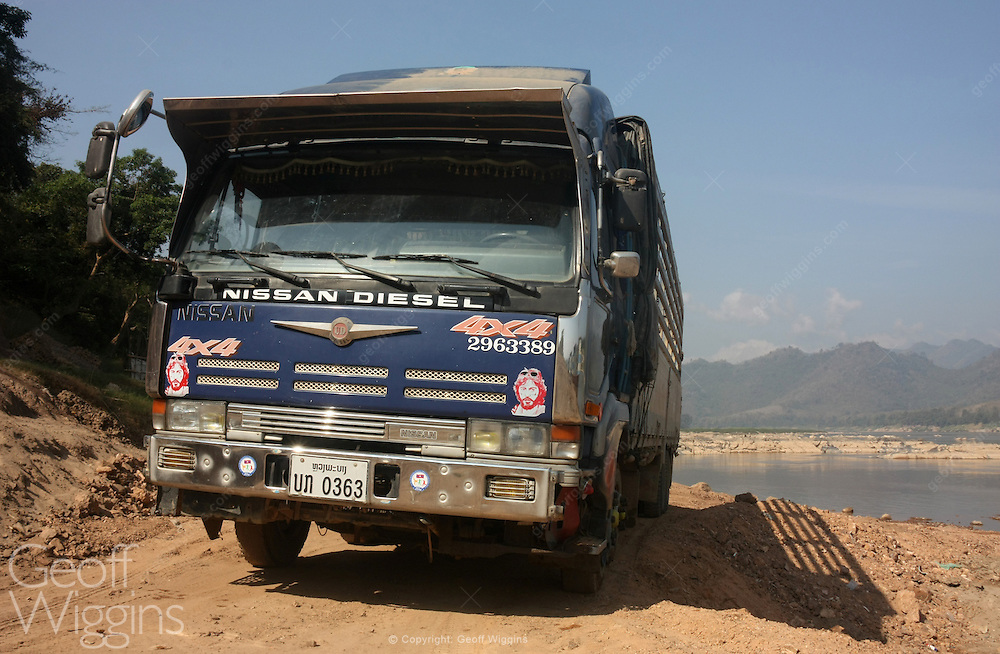Lao Nissan heavy truck on Mekong River, Lao PDR