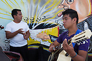 Carmelo Bonilla (left), 20, and Bonifaz Martinez Hernandez, 15, both from Xochitlan, Puebla,<br /> and members of the music group Corazon Huasteco, prepare to perform at the 2014 Mexican Network of Mining-Affected Peoples (REMA, for its initials in Spanish) Encounter. Hundreds of people from mining-affected communities throughout Mexico gathered for three days to exchange experiences, renew alliances and discuss strategies. Tlamanca, Zautla, Puebla, M&eacute;xico. March 15, 2014.