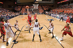 Maryland guard Greivis Vasquez (21) shoots over Virginia forward Adrian Joseph (30).  The Virginia Cavaliers defeated the Maryland Terrapins 91-76 at the University of Virginia's John Paul Jones Arena  in Charlottesville, VA on March 9, 2008.
