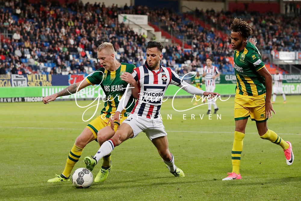 (L-R) Lex Immers of ADO Den Haag, Ismail Azzaoui of Willem II, Trevor David of ADO Den Haag