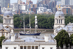© Licensed to London News Pictures. 01/09/2013<br /> One year ahead of the tall ships regatta.Tall ships add to the landscape of London by sailing on the river Thames today (1.09.2013) in Greenwich next to the Old Royal Naval College and National Maritime Museum.<br /> Photo credit :Grant Falvey/LNP