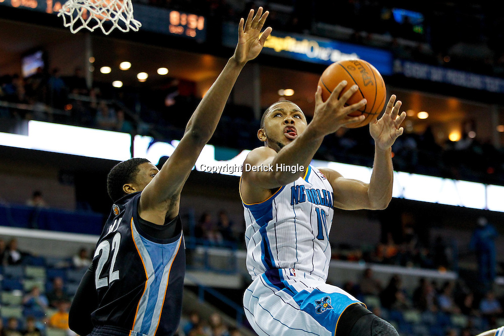 December 21, 2011; New Orleans, LA, USA; New Orleans Hornets shooting guard Eric Gordon (10) shoots over Memphis Grizzlies small forward Rudy Gay (22) during the second half of a preseason game at the New Orleans Arena. The Hornets defeated the Grizzlies 95-80.  Mandatory Credit: Derick E. Hingle-US PRESSWIRE