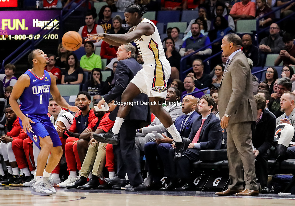 Oct 23, 2018; New Orleans, LA, USA; New Orleans Pelicans guard Jrue Holiday (11) throws the ball off the face of Los Angeles Clippers guard Avery Bradley (11) during the second quarter at the Smoothie King Center. Mandatory Credit: Derick E. Hingle-USA TODAY Sports