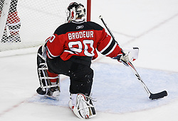 Apr 23, 2009; Newark, NJ, USA; New Jersey Devils goalie Martin Brodeur (30) watches a fight during the second period of game five of the eastern conference quarterfinals of the 2009 Stanley Cup playoffs at the Prudential Center.