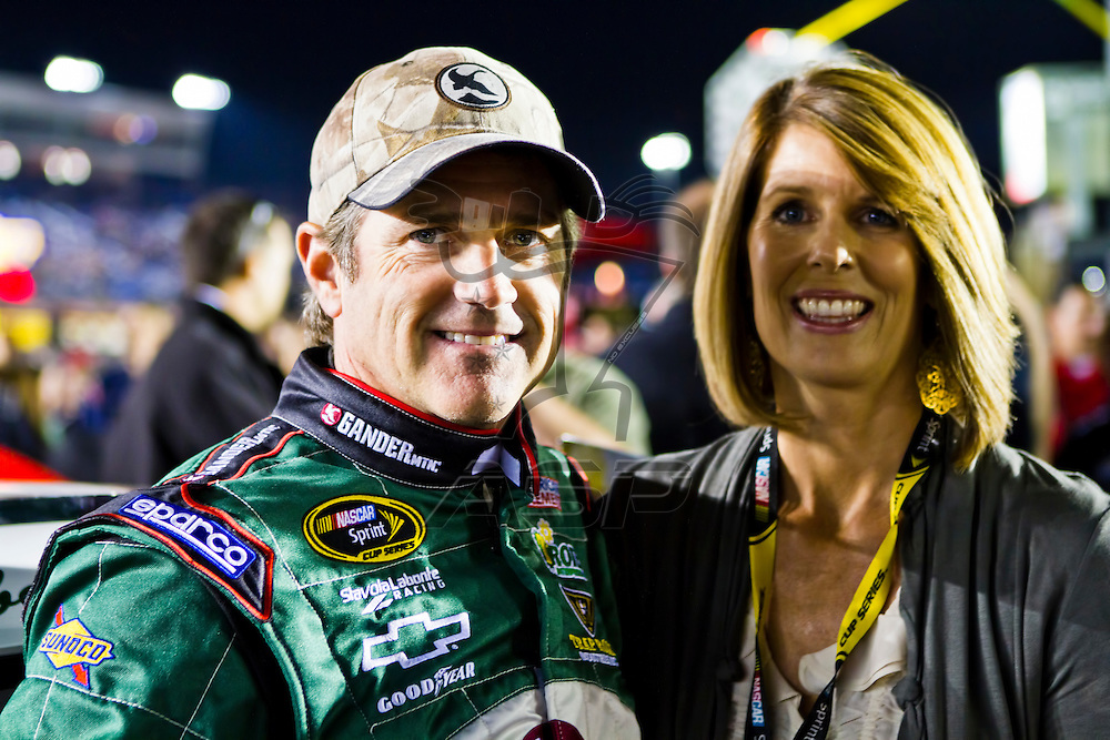 CONCORD, NC - OCT 16, 2010:  Bobby Labonte stands by his car with his wife before the Bank of America 500 race at the Charlotte Motor Speedway in Concord, NC.