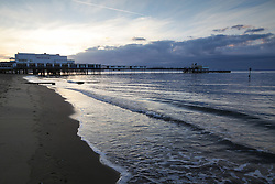 © Licensed to London News Pictures. 25/05/2015. Sandown, Isle of Wight, UK. Sunrise over Sandown Bay on the Isle of Wight this morning, 25th May 2015. The weather is set to be generally dry, with cloud cover and localised sunny spells. Photo credit : Rob Arnold/LNP