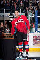 KELOWNA, CANADA - MARCH 15: Madison Bowey #4 of the Kelowna Rockets accepts the Scotty Munro Memorial Trophy on behalf of the Kelowna Rockets for the WHL regular season championship on March 15, 2014 at Prospera Place in Kelowna, British Columbia, Canada.   (Photo by Marissa Baecker/Getty Images)  *** Local Caption *** Madison Bowey;