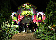 """Patrons view displays at a preview of the Philadelphia Flower Show, Saturday, March 2, 2002, in Philadelphia, Pa. The Philadelphia Flower Show runs from March 3-10, and is the largest indoor flower show in the world. This years theme is """"The Pleasures of the Garden."""" (Photo by William Thomas Cain/photodx.com)"""