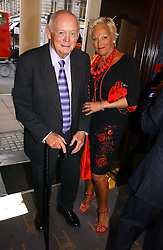 LORD MONTAGU OF BEAULIEU and  JEANNE MANDRY at a gala evening preview of Noel Coward's play Hay Fever in aid of Masterclass at The Theatre Royal, Haymarket, London on 26th April 2006.<br />