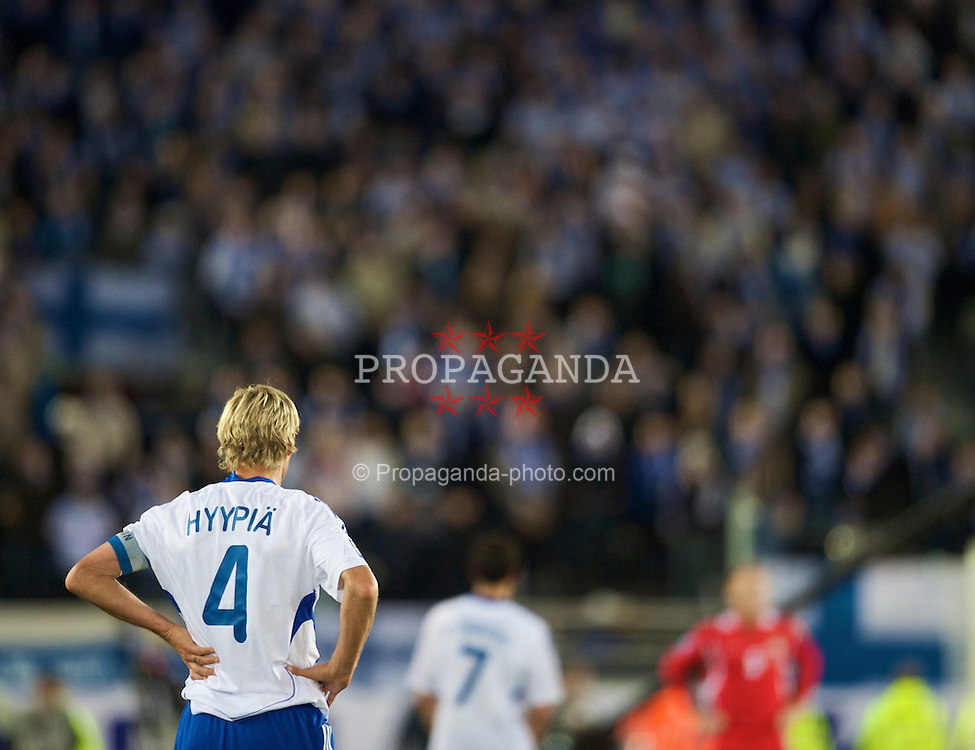 HELSINKI, FINLAND - Saturday, October 10, 2009: Finland's captain Sami Hyypia in action against Wales during the 2010 FIFA World Cup Qualifying Group 4 match at the Olympic Stadium. (Pic by David Rawcliffe/Propaganda)