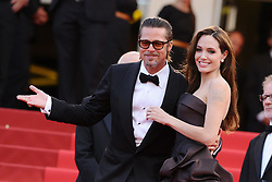 Angelina Jolie and Brad Pitt were married Saturday in the French hamlet of Correns, a spokesman for the couple says. Jolie and Pitt wed in a small chapel in a private ceremony attended by family and friends at Provence's Chateau Miraval. In advance of the nondenominational civil ceremony, Pitt and Jolie obtained a marriage license from a local California judge. The judge also conducted the ceremony in France. File photo : Brad Pitt and Angelina Jolie arriving for the screening of the film 'The Tree of Life' presented in competition in the Feature Films section as part of the 64th Cannes International Film Festival, at the Palais des Festivals in Cannes, southern France on May 16, 2011. Photo by Hahn-Nebinger-Genin/ABACAPRESS.COM