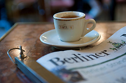 Detail of coffee and newspaper inside famous Cafe Einstein in Charlottenburg in Berlin Germany