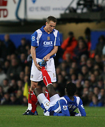 PORTSMOUTH, ENGLAND - SATURDAY, DECEMBER 9th, 2006: Matthew Taylor of Portsmouth gives some help to Benjani during the Premiership match at Fratton Park. (Pic by Chris Ratcliffe/Propaganda)
