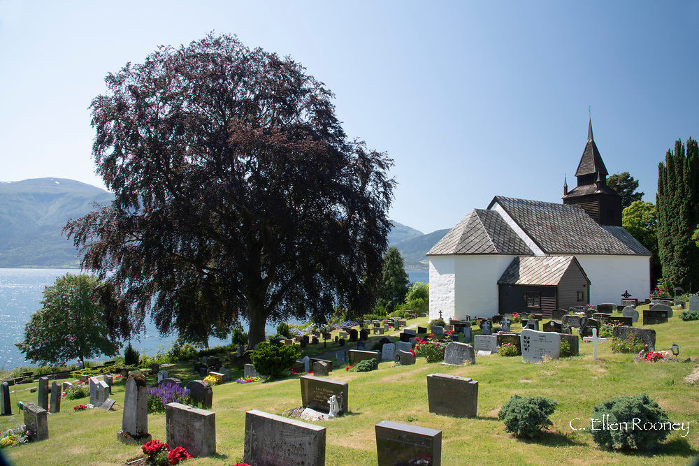 Leikanger Church and a cemetary in Leikanger on Sogne Fjord, Vestland, Norway