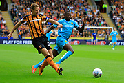 Burton Albion striker Lucas Akins (10) and Hull City defender Michael Dawson (21) during the EFL Sky Bet Championship match between Hull City and Burton Albion at the KCOM Stadium, Kingston upon Hull, England on 12 August 2017. Photo by Richard Holmes.
