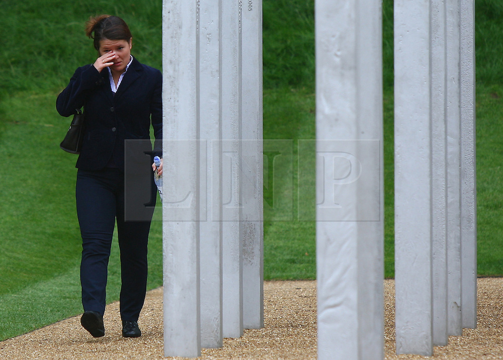 © under license to London News Pictures. London.  07/07/2011.  People pay their respects to the victims of the 7/7 bombings in London today (Thurs) by the Hyde Park Memorial on the 6th anniversary of the tragedy.  See special instructions. Mandatory credit Neil Hall/London News Pictures.