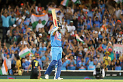 Virat Kohli raises his bat for his half century. T20 international, Australia v India. Sydney Cricket Ground, NSW, Australia, 25 November 2018. Copyright Image: David Neilson / www.photosport.nz