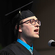 Goldey-Beacom College MBA 2015 graduate Matthew I. Bik, sing The Star Spangled Banner during Goldey-Beacom commencement exercise Friday, May 1, 2015, at Joseph West Jones College Center on the campus of Goldey-Beacom College in Wilmington Delaware.